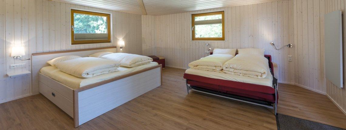 Baumhaus Eichenhoehe Bett Sofa